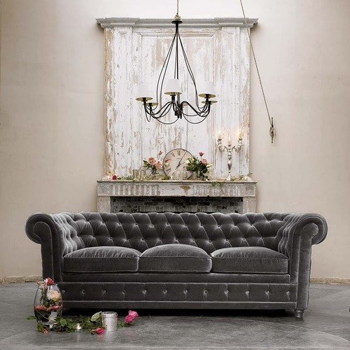 dark_gray_velvet_tufted_sofa