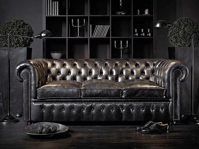 Svart chesterfield soffa
