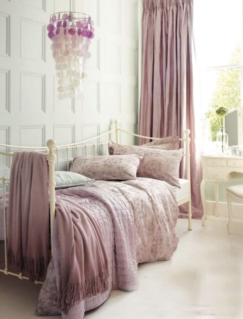 Antique rose bed and curtains