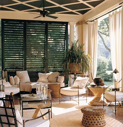A louvered partition maintains the privacy of this porch without sacrificing access to light or breezes.
